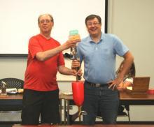 Neil Whitmore receives the Doug Mark Humor Award from Len Piggin